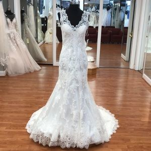 Ivory wedding gown with floral lace print